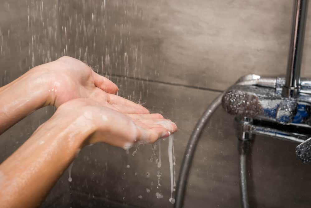 Water drops falling on female hands