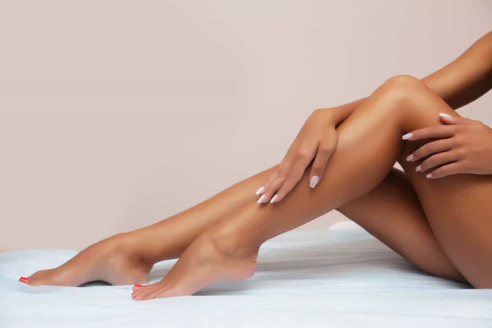 long female tanned legs with perfect smooth soft skin