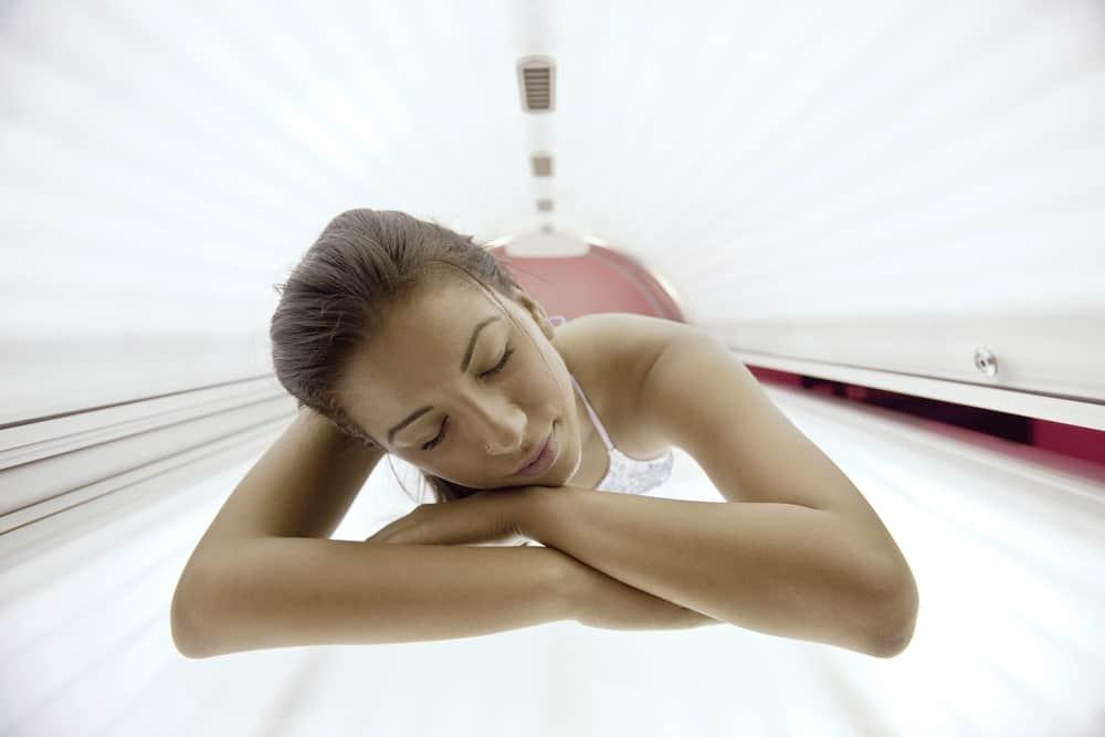 woman have tanning skin treatment in modern solarium